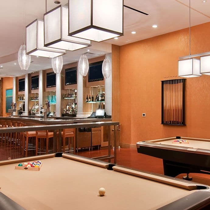 David's Club features pool tables and large overstuffed chairs