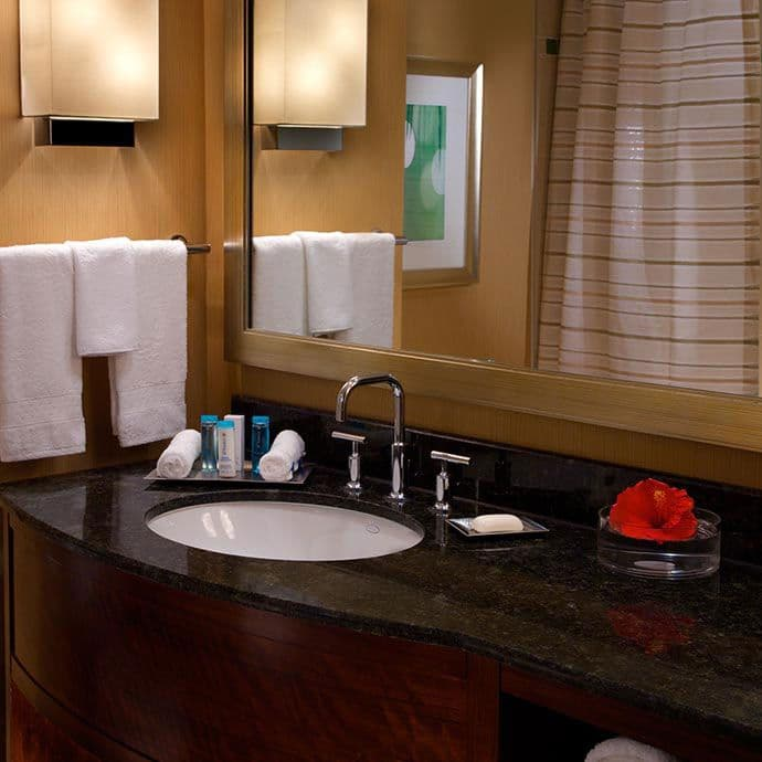 Pamper yourself in our residential-style bathroom with granite vanity, featuring Peter Thomas Roth bath amenities